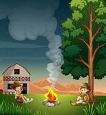 Two explorers making a campfire — Stock Vector