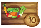 A wooden frame with ten vegetables — Stock Vector