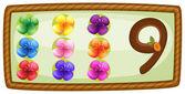 A frame with nine flowers — Cтоковый вектор