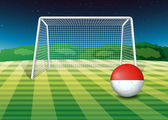 A ball at the soccer field with the flag of Monaco — Stock Vector