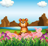 A cute bear near the flowers at the riverbank — Stock Vector