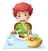 A boy eating — Stock vektor