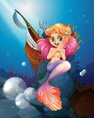 A pretty mermaid under the sea near the rocks — Stock Vector