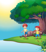 A boy and a girl playing near the giant tree — Stock vektor