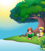 A boy and a girl reading under the tree — Stockvector