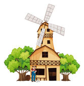 A farmer in front of the barnhouse — Stock Vector