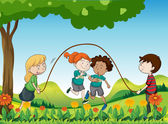 Four kids playing under the tree — Stock Vector