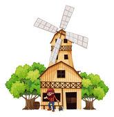 A woodman holding an axe beside the wooden building — Stock Vector