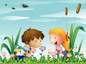 A cute girl and a cute boy watching the flowers — Stock Vector