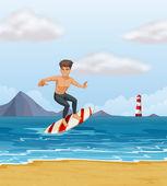 Un ragazzo di surf sulla spiaggia — Stok Vektör