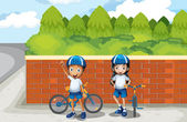 Two young bikers at the street — Stock Vector