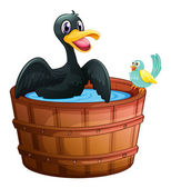 A duck and a bird at the bathtub — Vettoriale Stock