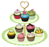 A cupcake tray with cupcakes — Stock Vector