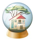 A cute crystal ball with a big house inside — Stock Vector