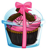 A cupcake with a pink icing — Stock Vector