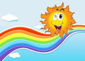 A smiling sun near the rainbow — Stock Vector