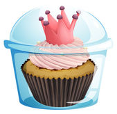 A cupcake with a crown inside the disposable container — Stock Vector