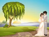 A couple across the tree — Stock Vector
