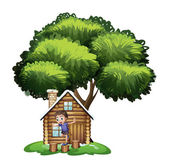 A boy playing outside the house under the tree — Stock Vector