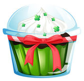 A cupcake container with a green cupcake and a pink ribbon — Stock Vector