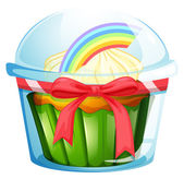 A container with a cupcake inside decorated with a ribbon — Stock Vector