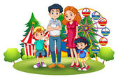 A family at the amusement park — Stock Vector