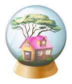 A crystal ball with a pink house inside — Stock Vector
