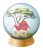 A crystal ball with a house — Stock Vector