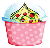 A cupcake inside a dotted pink container — Vector de stock