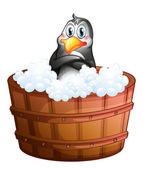 A barrel with a penguin — Stockvector