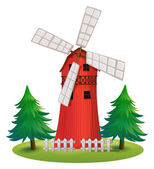 A tall wooden building with a windmill — Stock Vector