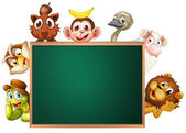 A blackboard surrounded with animals — Stock Vector