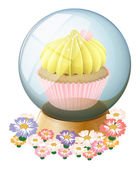 A clear crystal ball with a cupcake inside — Stock Vector