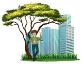 A man standing under the tree across the offices — Stock Vector