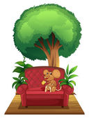 A chair under the tree with a mouse — Stock Vector