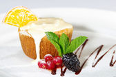 Cake with milk cream, lemon, cranberry and blackberry — Stock Photo