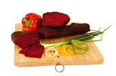 Jerky Kazakh (sur-et) on a wooden board — Stock Photo