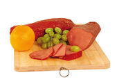 Smoked horse meat (zhaya) on a wooden board — Stock Photo