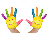 Two colorful hands with smile — Stock Photo