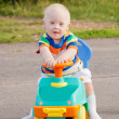 Baby boy with Down syndrome driving — Stock Photo