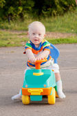 Baby boy with Down syndrome driving — 图库照片