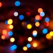 Blurred colorful circles bokeh of Christmaslight against dark background — Stock Photo #12728625