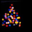 Olorful circles bokeh of Christmaslight in the form of a Christmas tree — Stock Photo