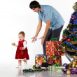 Father giving little daughter a Christmas gift — Stock Photo