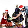 Father giving little daughter a Christmas gift — Foto Stock