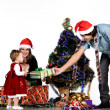 Father giving little daughter a Christmas gift — Stock Photo #12849443