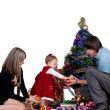 Family - father mother and baby daughter in a smart dress decorating Christmas tree — 图库照片 #12849450