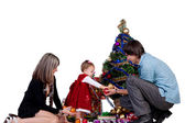 Family - father mother and baby daughter in a smart dress decorating Christmas tree — Stock Photo