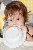 Hungry soiled baby — Stock Photo