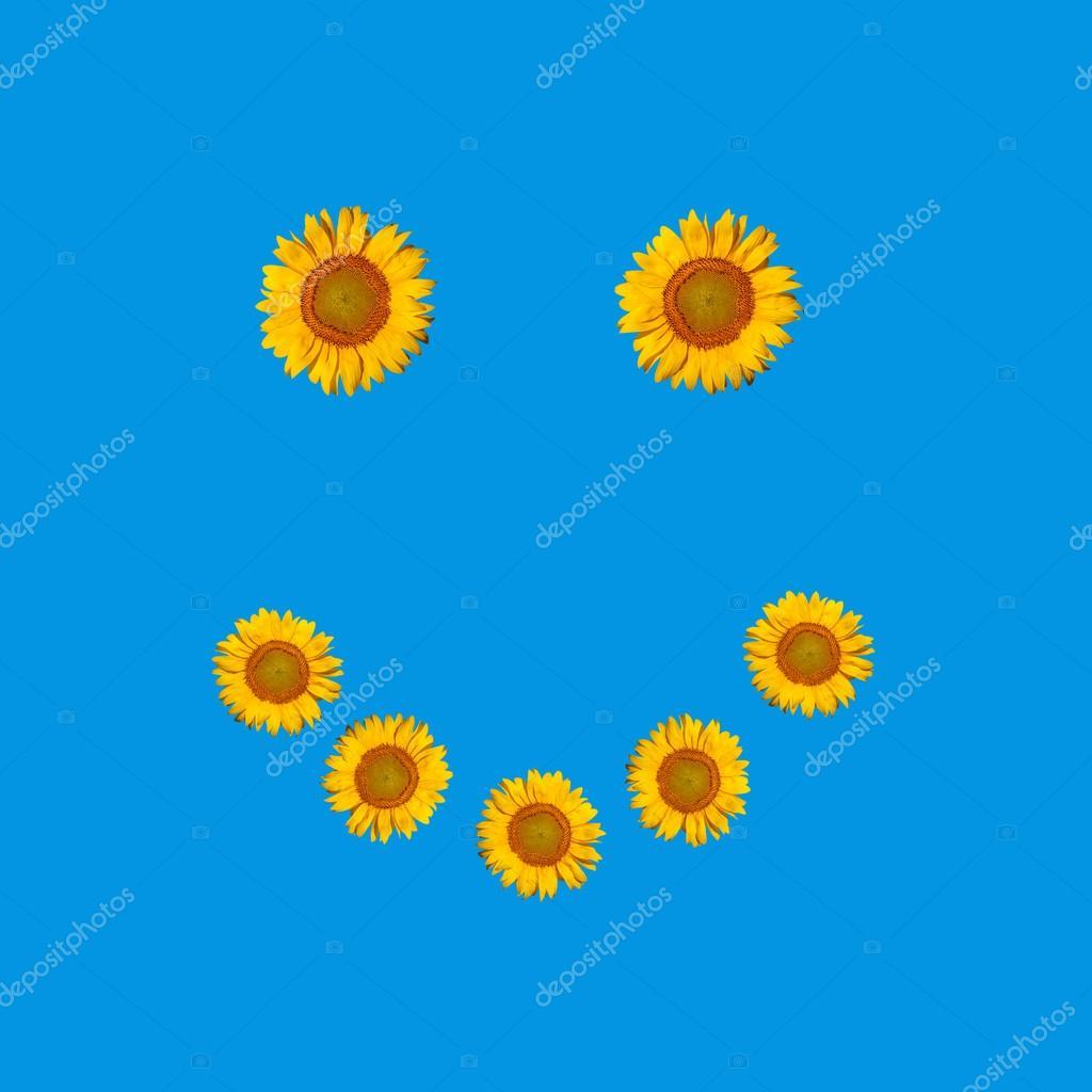 Smiley face symbol posed of flowers sunflowers — Stock © Vitalinka